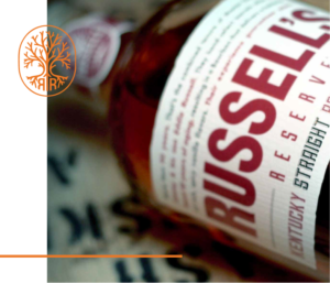 Russell's Reserve 10 Year Bottle with orange emblem graphic at left
